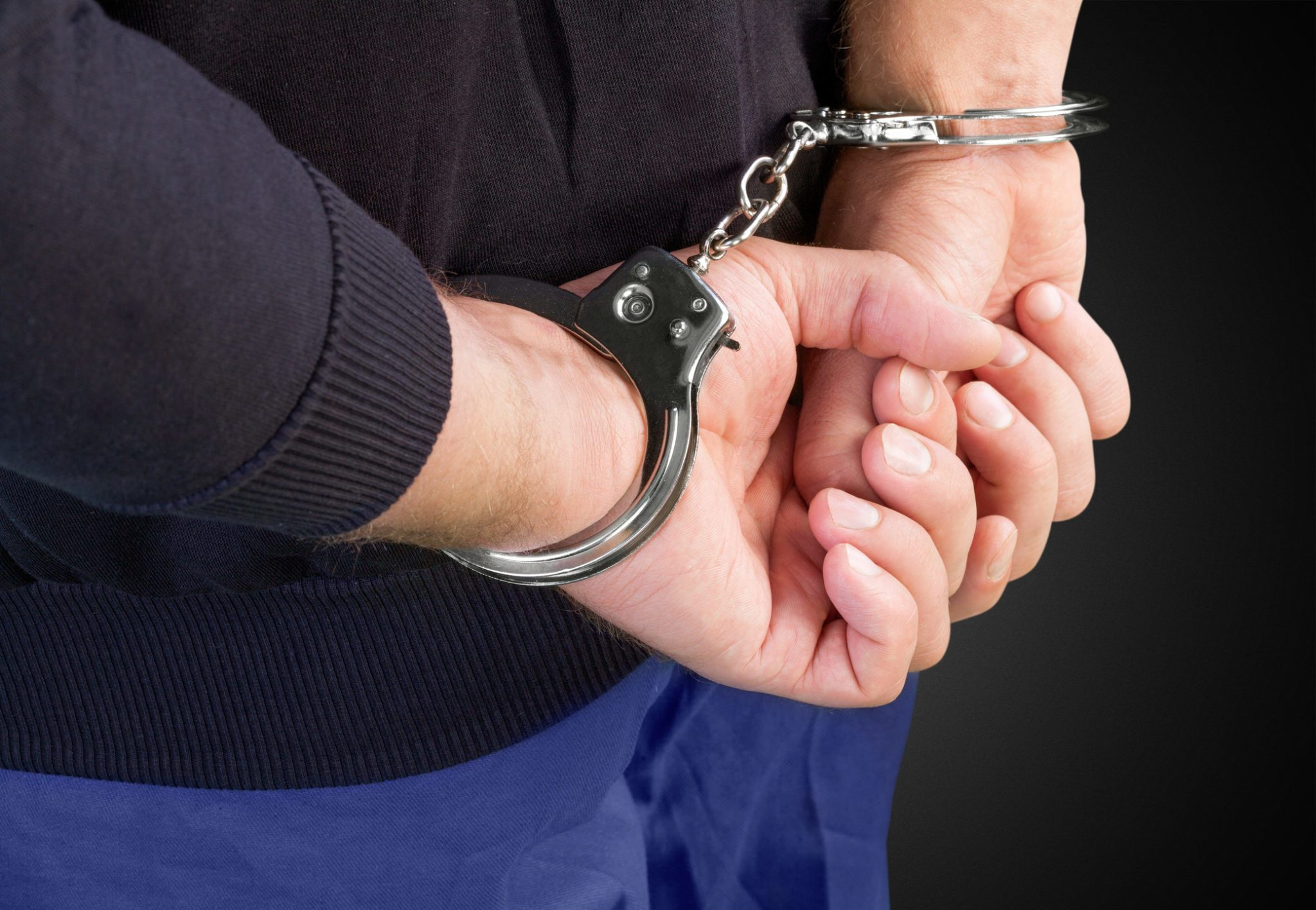 Arrested handcuffed criminal